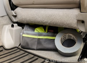 Tools and duct tape stashed under the passenger seat for quick access. Normally the tape lives in the spare tire well which becomes hard to access when we're fully packed.